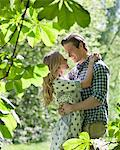 Couple hugging outdoors Stock Photo - Premium Royalty-Free, Artist: Blend Images, Code: 635-05550284