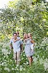 Parents carrying their children piggyback outdoors Stock Photo - Premium Royalty-Freenull, Code: 635-05550291