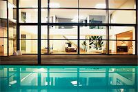 Pool and windows of modern house Stock Photo - Premium Royalty-Freenull, Code: 635-05550324