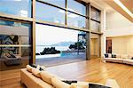 Sofas and sliding doors in open modern house Stock Photo - Premium Royalty-Freenull, Code: 635-05550378
