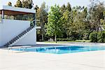 Swimming pool with diving board Stock Photo - Premium Royalty-Free, Artist: Blend Images, Code: 635-05550379
