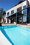 Pool outside modern house Stock Photo - Premium Royalty-Freenull, Code: 635-05550385