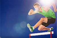 Athlete jumping hurdles Stock Photo - Premium Royalty-Freenull, Code: 635-05550533