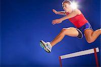 Athlete jumping over hurdles Stock Photo - Premium Royalty-Freenull, Code: 635-05550564