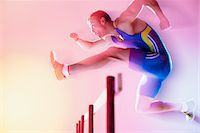 Blurred view of athlete jumping hurdles Stock Photo - Premium Royalty-Freenull, Code: 635-05550574