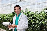 Scientist reading clipboard in greenhouse Stock Photo - Premium Royalty-Freenull, Code: 635-05550738