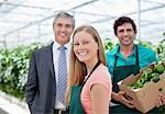 Businessman and workers in greenhouse Stock Photo - Premium Royalty-Freenull, Code: 635-05550741