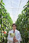 Scientist holding clipboard in greenhouse Stock Photo - Premium Royalty-Freenull, Code: 635-05550744