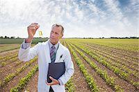 Scientist examining liquid in test tube outdoors Stock Photo - Premium Royalty-Freenull, Code: 635-05550780
