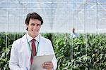 Scientist writing on clipboard in greenhouse Stock Photo - Premium Royalty-Freenull, Code: 635-05550790
