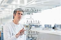 results - Scientist using touch screen in lab Stock Photo - Premium Royalty-Freenull, Code: 635-05550863