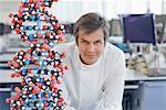 Scientist with molecular model in lab Stock Photo - Premium Royalty-Free, Artist: Cultura RM, Code: 635-05551001