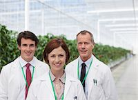 Scientists smiling in greenhouse Stock Photo - Premium Royalty-Freenull, Code: 635-05551002