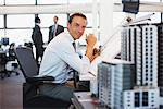 Architect working at desk in office Stock Photo - Premium Royalty-Freenull, Code: 635-05551025