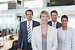 Business people smiling together in office Stock Photo - Premium Royalty-Freenull, Code: 635-05551064