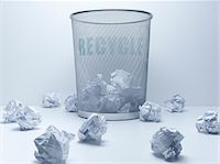 Crumpled balls of paper beside recycling bin Stock Photo - Premium Royalty-Freenull, Code: 635-05551100
