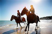 Girls riding horses on beach Stock Photo - Premium Royalty-Freenull, Code: 635-05551122