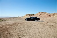 Rolls Royce car parked on unpaved road with tire tracks Stock Photo - Premium Royalty-Freenull, Code: 693-05552691