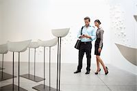 exhibition - Couple with Glazed ceramics boats in art gallery Stock Photo - Premium Royalty-Freenull, Code: 693-05552770