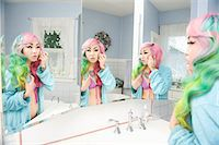 Young woman applying makeup with multiple mirror reflections Stock Photo - Premium Royalty-Freenull, Code: 693-05552809
