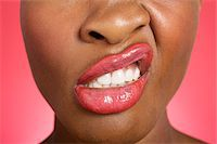 Close up of woman making a face Stock Photo - Premium Royalty-Freenull, Code: 693-05552900