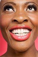 Close up of cheerful woman looking up Stock Photo - Premium Royalty-Freenull, Code: 693-05552902