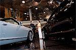 Salesman talking to woman in automobile showroom Stock Photo - Premium Royalty-Free, Artist: Blend Images, Code: 693-05552984