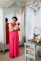 Drag queen wearing nightwear holding doll Stock Photo - Premium Royalty-Freenull, Code: 693-05553329