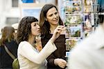 Female tourists looking at postcards Stock Photo - Premium Royalty-Free, Artist: Arcaid, Code: 632-05553511