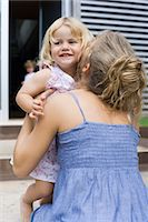 daughter kissing mother - Mother embracing young daughter Stock Photo - Premium Royalty-Freenull, Code: 632-05553691