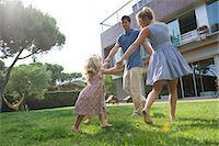 Family playing ring-around-the-rosy outdoors Stock Photo - Premium Royalty-Freenull, Code: 632-05553822