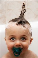 Little boy in bath with wet hair in mohawk, portrait Stock Photo - Premium Royalty-Freenull, Code: 632-05554011
