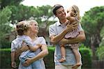 Parents carrying children outdoors Stock Photo - Premium Royalty-Freenull, Code: 632-05554101