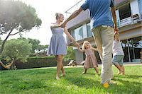 Family playing ring-around-the-rosy outdoors Stock Photo - Premium Royalty-Freenull, Code: 632-05554188