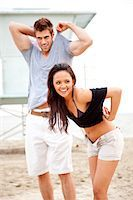 Young Couple Undressing on Beach Stock Photo - Premium Rights-Managednull, Code: 822-05554386