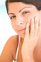 ring hand woman - Young Woman Resting Chin on Hand Stock Photo - Premium Rights-Managednull, Code: 822-05554411