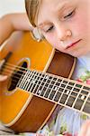 Young Girl Playing Guitar Stock Photo - Premium Rights-Managed, Artist: ableimages, Code: 822-05554466