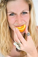 ring hand woman - Woman Eating Slice of Orange Stock Photo - Premium Rights-Managednull, Code: 822-05554579
