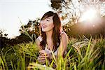 Smiling Young Woman In a Field Stock Photo - Premium Rights-Managed, Artist: ableimages, Code: 822-05554591