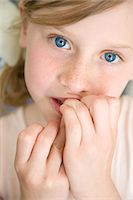 preteens fingering - Young Girl with Fingers in Front of Mouth Stock Photo - Premium Rights-Managednull, Code: 822-05554604