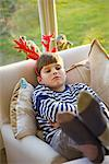 Sulking Boy Wearing Christmas Antlers Stock Photo - Premium Rights-Managed, Artist: ableimages, Code: 822-05554635