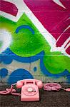 Pink Telephone in front of Graffiti Covered Wall Stock Photo - Premium Rights-Managed, Artist: ableimages, Code: 822-05554701