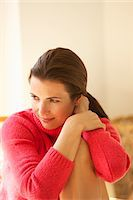 Woman Hugging One Knee and Touching her Neck Stock Photo - Premium Rights-Managednull, Code: 822-05554719