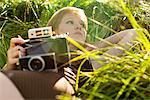 Woman Lying on Grass Holding Vintage Camera Stock Photo - Premium Rights-Managed, Artist: ableimages, Code: 822-05554751