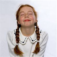 preteen girl pigtails - Smiling Girl with Eyes Closed and Head Tilted Back Stock Photo - Premium Rights-Managednull, Code: 822-05554800