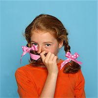 preteen beauty - Girl Covering Mouth with Braid Stock Photo - Premium Rights-Managednull, Code: 822-05554816