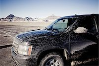 Dirty 4x4 Car Parked on the Bonneville Salt Flats Stock Photo - Premium Rights-Managednull, Code: 822-05554865