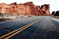 rugged landscape - Double Yellow Line on Highway and Sandstone Formations Stock Photo - Premium Rights-Managednull, Code: 822-05554877
