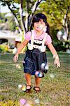 Smiling Young Girl Walking in Garden Stock Photo - Premium Rights-Managed, Artist: ableimages, Code: 822-05554957