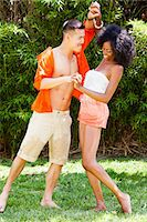 Young Couple Messing Around in Garden Stock Photo - Premium Rights-Managednull, Code: 822-05554959